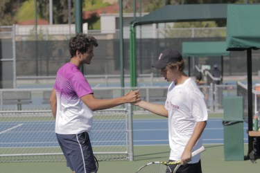 Riverside City College freshmen Antoine Voisin and Grady Harrell come together during their doubles match against Saddleback in the OEC Tournament on April 10