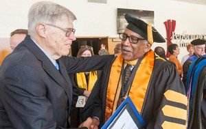 Celebrate: RCC's new president, Wolde-Ab Isaac, shakes the hand of Irving Hendricks former RCCD interim chancellor, at the Presidential Investiture held in Landis Auditorium on Oct. 12. Photo courtesy of RCC.edu