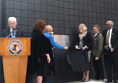 RCCD Board of Trustees President Virginia Blumenthal and Janet Green, Area 4 Trustee, unveil the dedication plaque on Centennial Plaza March 13. | Stacy Soriano | Viewpoints