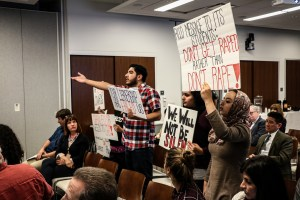 Protesters attend Board of Trustees meeting