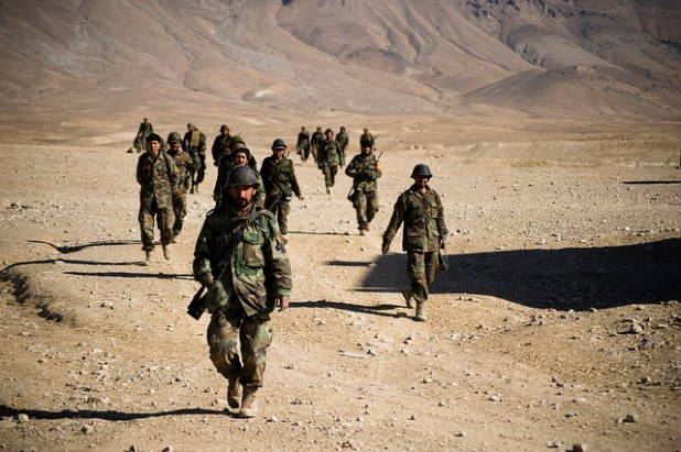 Afghan National Army recruits walk back to their formation after completing marksmanship training during Basic Warrior Training in Kabul Military Training Center. (Photo by DVIDSHUB, Creative Commons License)