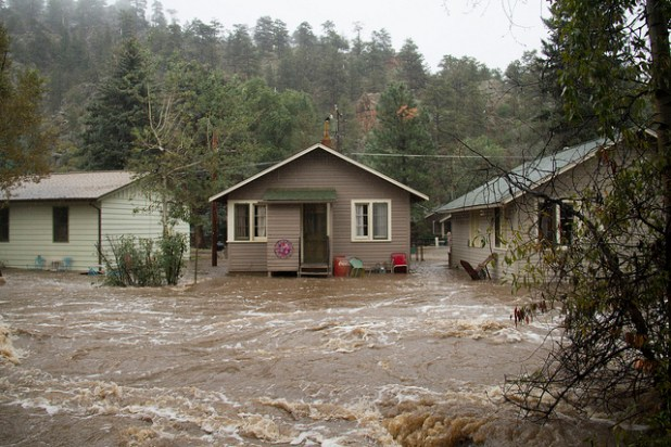 Flood water gushing through a street in Estes Park, Colorado, on September 12. (Photo by Kevin Beaty, Creative Commons License)