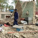 A man in Awaran stands amid the remains of what used to be his home. (Photo by Islamic Relief via IRIN)