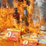 Members of non-government public movement Nastup ('The attack') burn goods made in Russia during their protest in front of the Russian embassy building in Kiev, Ukraine, 16 August 2013. The Customs Service of the Russian Federation put all Ukrainian imports on the list of potentially dangerous goods, which halted the shipment of goods from Ukraine for an indefinite. (Photo by EPA/SERGEY DOLZHENKO via East Asia Forum)