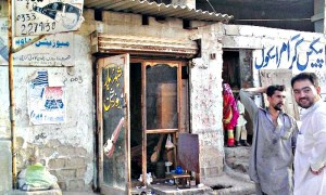 Sohail's unfancy rustic shop which serves as a rare Rubab manufacturing facility in Pakistan. (Photo via Dawn.com)