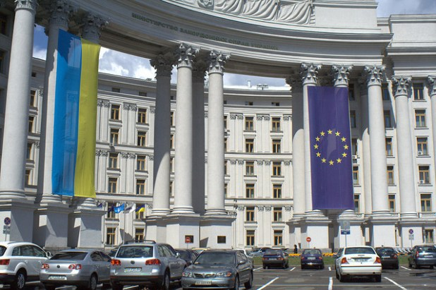 Ukrainian and EU flags are hanging from a landmark building in Kiev. (Photo by by Slava Murava Kiss)