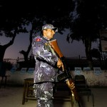 Nepalese police stand guard as final preparation are made at a local polling station on the eve of the general elections in Kathmandu, Nepal,  November 18, 2013. (Photo by Bangladesh Press)