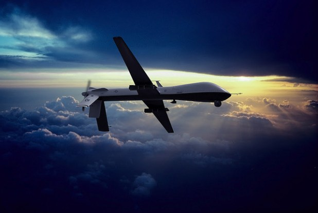 MQ-1 Predator Unmanned Drone with Hellfire Missiles Flying at Sunset. (Photo by cmccain202dc, Creative Commons License)