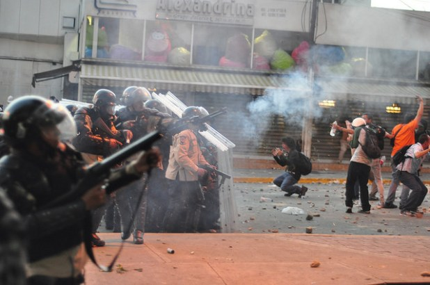 Police fire teargas at protesters in Caracas, Venezuela, on February 15. (Photo by andresAzp, Creative Commons License)