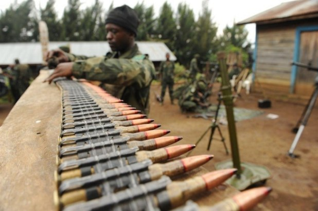 A member of the FARDC's 601 regiment, also known as the Chinois commandos, in the North Kivu province village of Tongo cleans ammunition as part of preparations for operations against the FDLR armed group. (Photo by Guy Oliver/IRIN)