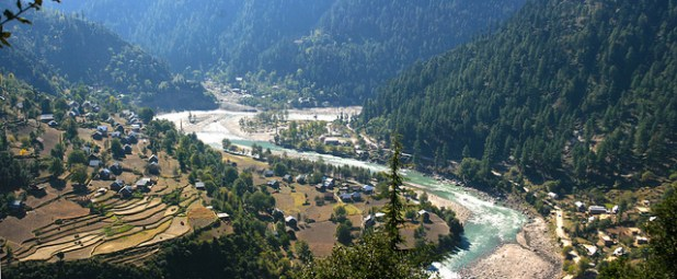 Neelum River - separating the Keran Village of Pakistan-administered Kashmir (right side) from the Keran Village in Indian-administered Kashmir (left side). People living on both sides are mostly relatives. (Photo by Muzaffar Bukhari, Creative Commons License)