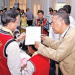 Myanmar Peace Center official U Hla Maung Shwe (right) speaks with an ethnic official in Yangon on April 4. (Photo by Thiri via The Myanmar Times)