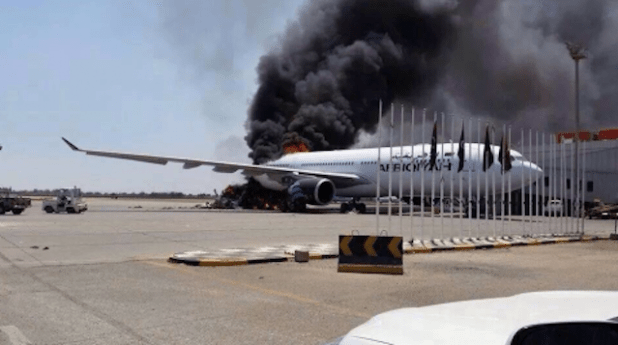 A burning airliner at the Tripoli International Airport. (Photo via social media/Libya Herald)