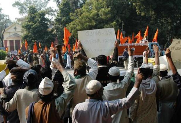 Both sides have legitimate questions, but they can get answers to these only when they start talking without preconditions or standing on ceremony. File picture of members of a Muslim front and a right wing organization at a demonstration in New Delhi over the Babri Masjid demolition. (Photo by V.V. Krishnan, via The Hindu)