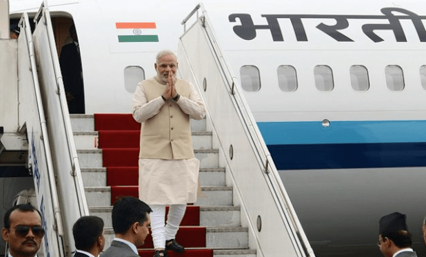 Indian Prime Minister Narendra Modi stepping out of his plane at the start of his Nepal visit. (Photo by Nepal Information Department)