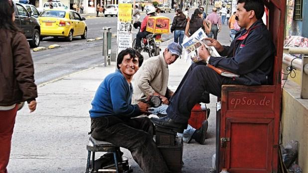 A shoe-shiner in Quito in Ecuador. (Photo by epSos .de, Creative Commons License)