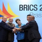 Russian President Vladimir Putin, Prime Minister of India Narendra Modi, President of Brazil Dilma Rousseff, President of China Xi Jinping and President Jacob Zuma take a family photograph at the 6th BRICS Summit held at Centro de Eventos do Ceara' in Fortaleza, Brazil. (Photo by GovernmentZA, Creative Commons License)