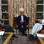 U.S. Secretary of State John Kerry sits with Abdullah Abdullah, left, and Ashraf Ghani, right, at the U.S. Embassy in Kabul, Afghanistan on July 12, 2014, after he helped broker an agreement on a technical and political plan to resolve the disputed outcome of the election between them. (State Department photo/ Public Domain)