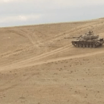 Turkish army's tanks take position along the country's  border with Syria. (Photo from videostream)