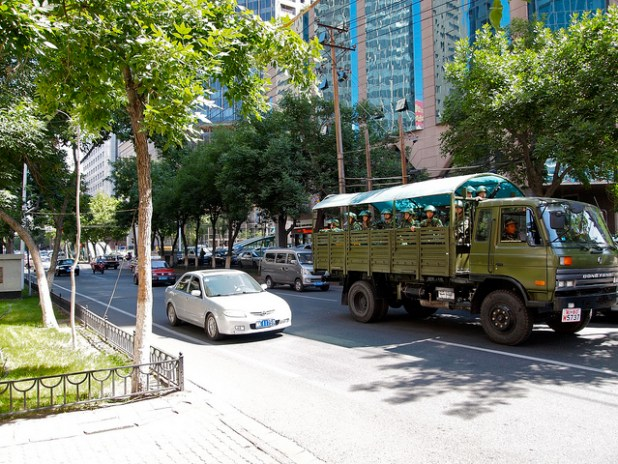 The army driving around on Jiefang North Road in downtown Urumqi, Xinjiang, China. (Photo Remko Tanis, Creative Commons License)