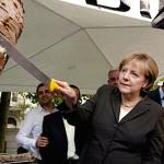 German Chancellor Merkel is seen cutting döner from a spit. The döner industry, which is mostly in the hands of the Turkish community, sells nearly 300 tons daily in Germany.(Photo via Today's Zaman)
