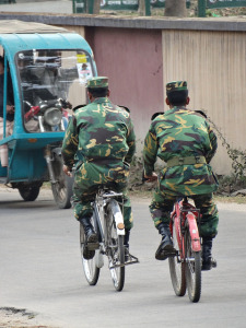 Bangladeshi army soldiers riding bicycles in a region in the Chittagong Hill Tracts. (Photo by Adam Jones, Creative Commons License)