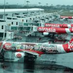 Air Asia airliners at the Kuala Lumpur Airport. (Photo by Fabio Achilli, Creative Commons License)