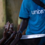 UNICEF and AJCOM team on the ground sensitizing people in Conakry (Guinea) about Ebola. Teaching children handwashing and its importance. (Photo by UNICEF Guinea, Creative Commons License)
