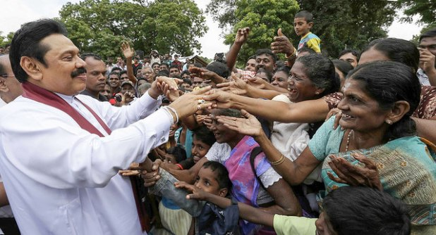 President Mahinda Rajapaksa (L) at a campaign rally in December last. (Photo via President Mahinda Rajapaksa's office, Creative Commons License)