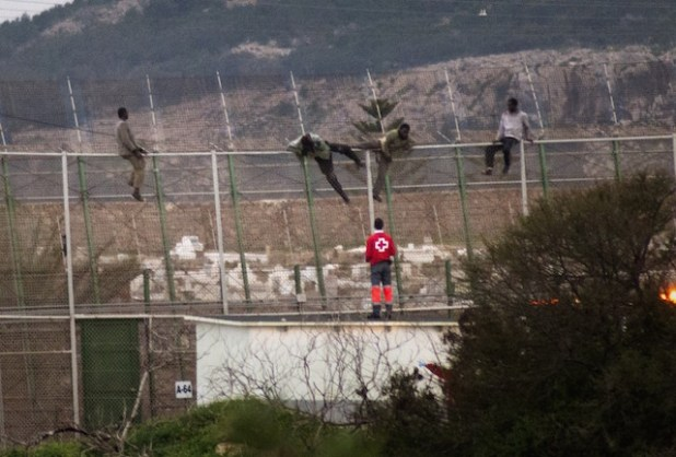 African migrants attempting to enter the Spanish enclave of Melilla. (Photo via The North Africa Post)