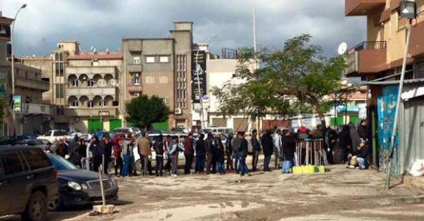 People lining up outside a bakery for bread in Benghazi. (Photo by Mutaz Gedalla)