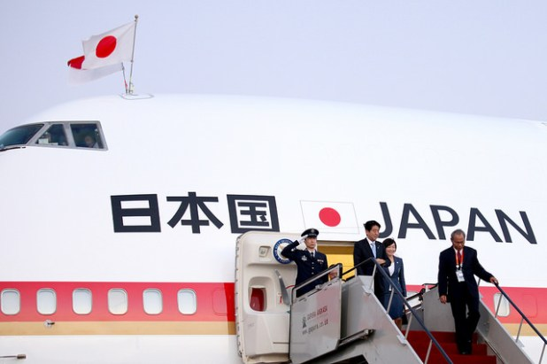 Japan's PM Shinzo Abe coming out of his official aircraft. (Photo via APEC 2013, Creative Commons  License)