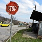 A stop sign and an empty bus stop at the Bulgarian village of Raykova mogila near the Turkish border. (Photo by Hristo Rusev, via New Internationalist)