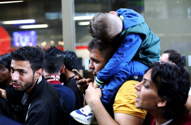 Stranded Syrian refugees in Vienna. (Photo by Josh Zakary, Creative Commons License)