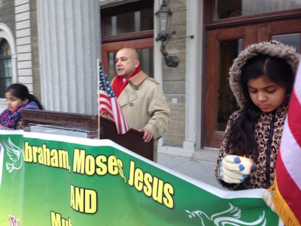 Pakistani community activist Ali Akbar Mirza addressing the vigil at Nassau County Executive building in Minneola on Jan 1. (Photo by ViewsWeek)