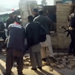 Police investigators inspect the blast site in Mardan, a major city in Khyber Pakhtunkhwa province on Dec. 29 which left 26 people dead.