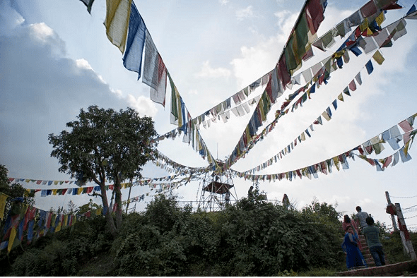 Buddhist flags – people have freedom of religion in Nepal, which is why so many Tibetan Buddhists have stayed there. (Photo by Emily Korstanje, via New Internationalist)