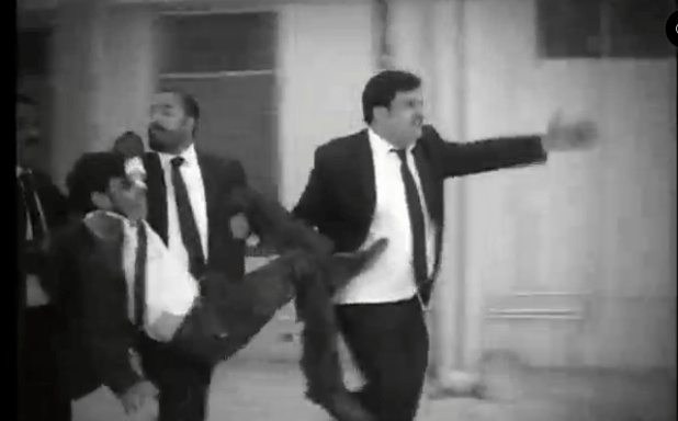 Lawyers carrying an injured colleague for medical hel after a suicide terrorist attack killed more than 70 people in Quetta, Pakistan, on August 8. (Photo via video stream)