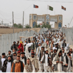 People crossing over into Pakistan from Afghanistan at Chaman border.