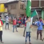 Kashmiri youth holding Pakistani flags celebrating Pakistan's 70 independence day in India-administered Kashmir. (Photo via video stream)