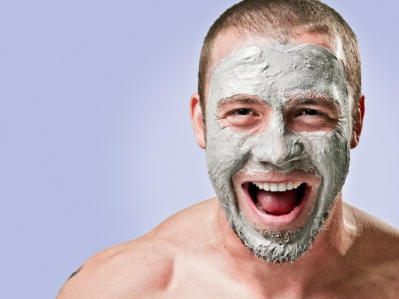 Man smiling big with face mask on