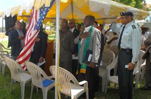 Several look on during the playing of the national anthem at the Rededication Ceremony of the Verne I. Richards Veterans Memorial Park on the waterfront in Frederiksted Monday morning. dnp by CRISTIAN SIMESCU