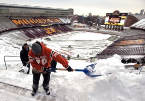 Eric Ousley of Minneapolis, shovels along with work crews as they remove snow from the stands at TCF Stadium, home of the University of Minnesota football team, Thursday, Dec. 16, 2010, in Minneapolis. The Minnesota Vikings will host the Chicago Beats at TCF Bank Stadium in an NFL football game on Monday, after there wasn't enough time to repair the Metrodome's tattered and deflated roof. (AP Photo/Craig Lassig)