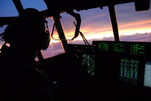 Lt. Col. Mark Carter looks at the sunset after flying nine hours on a Hurricane Ike mission on board a WC-130J Hercules Sept. 10 over the Gulf of Mexico. The Air Force Reserve Hurricane Hunters of the 403rd Wing at Keesler Air Force Base, Miss, fly 24-hours-a-day, collecting data inside the heart of Hurricane Ike. The data collected by the Hurricane Hunters improve the National Hurricane Center forecast by 30 percent. Colonel Carter is a pilot with the 403rd Wing. (U.S. Air Force photo/Maj. Chad E. Gibson)