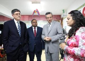 U.S. Treasury Secretary Jack Lew (L) and Puerto Rico's Governor Alejandro Garcia Padilla (2nd R) listen to kindergarden teacher Gloria Rivera during their visit to the elementary school Eleonor Roosevelt in San Juan, Puerto Rico, May 9, 2016. REUTERS/Alvin Baez -