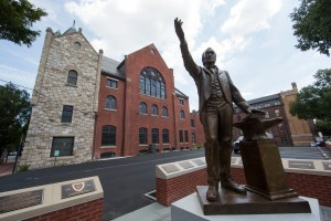 A sculpture depicting Bishop Richard Allen stands in front of Mother Bethel African Methodist Episcopal Church in Philadelphia, Wednesday, July 6, 2016. The church marks its 200th anniversary in the city where it was founded by a former slave. (AP Photo/Matt Rourke)