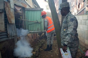 Dominican Air Force personnel fumigate various locations in Santo Domingo against the Aedes aegypti mosquito, vector of the Zika virus, on february 19, 2016. The Dominican Republic said Saturday it has 10 confirmed cases of the mosquito-borne Zika virus, the ailment suspected of causing serious birth defects in newborns. AFP PHOTO/ERIKA SANTELICES / AFP / ERIKA SANTELICES (Photo credit should read ERIKA SANTELICES/AFP/Getty Images)