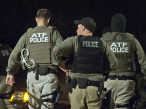 HYATTSVILLE, MD- NOVEMBER 19 Authorities from the Bureau of Alcohol, Tobacco, Firearms and Explosives search a home where a defendent lived, who sold narcotics to undercover officers and agents in Hyattsville, Maryland on November 08, 2011. This month, D.C. police and federal agents from ATF, FBI and ICE closed a year-long and risky undercover investigation which brought more than 60 prosecutions cases to federal courts and D.C. Superior court, for charges such as robbery, gun trafficking to methamphetamine distribution to conspiracy to commit bank robbery. Police targeted 77 people in the sting, seized millions in drugs and purchased or captured 151 guns, including assault rifles and 9mm pistols with brand new silencers, weapons rarely seen on city streets. (Photo by Marvin Joseph/The Washington Post via Getty Images)