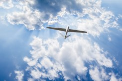 Unmanned aerial vehicle in cloudy sky Vigilant Aerospace