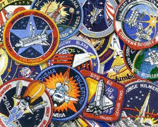 https://i0.wp.com/vigilantcitizen.com/wp-content/uploads/2011/06/astronaut_patches01a.jpg